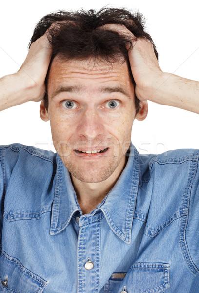 Confondre jeune homme mains tête isolé blanche Photo stock © pzaxe