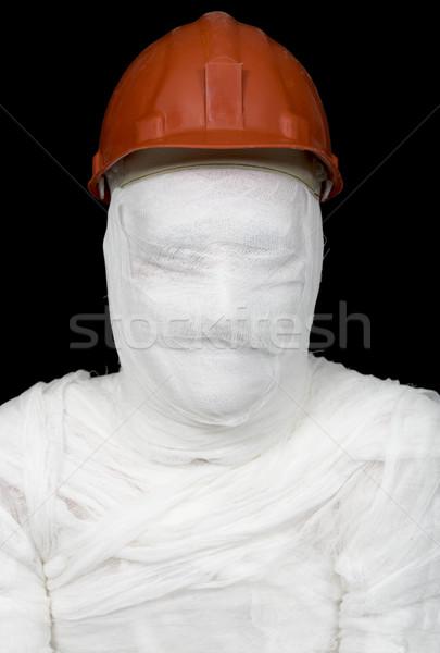 Stock photo: Bandaged worker in helmet