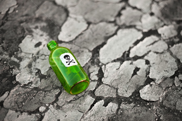 Bottle on poisoned ground Stock photo © pzaxe