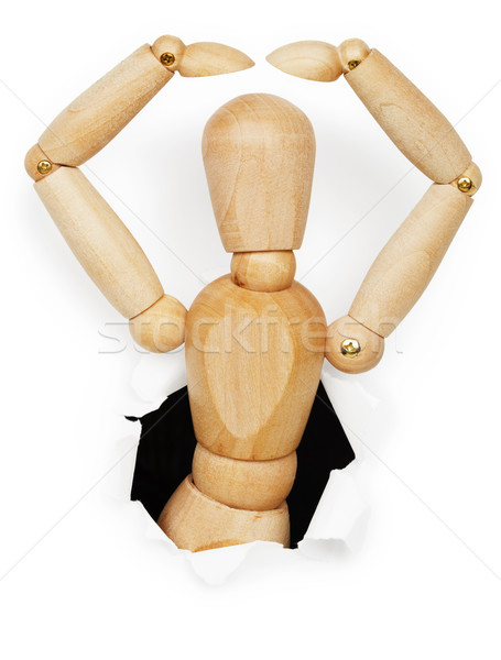 Wooden man leaned out of hole Stock photo © pzaxe