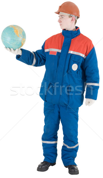 Builder and terrestrial globe Stock photo © pzaxe