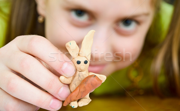 Girl with a plasticine rabbit Stock photo © pzaxe