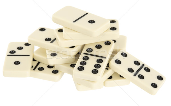 Pile of dominoes isolated on white background Stock photo © pzaxe