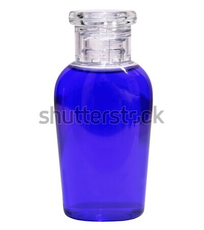 Small bottle with blue liquid on white background Stock photo © pzaxe