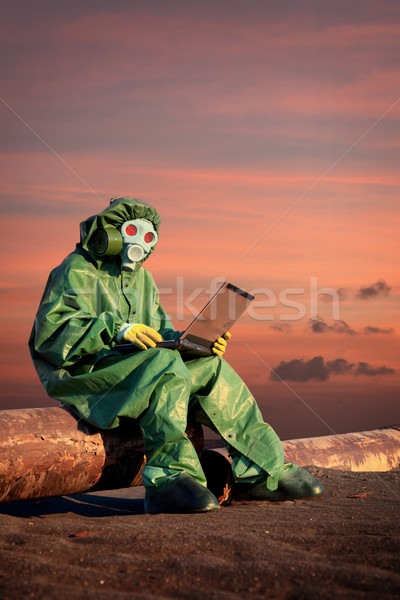 Man in protective suit works in contamination area Stock photo © pzaxe