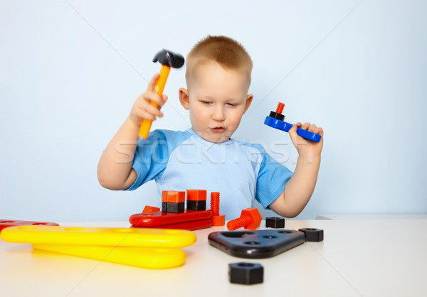 Stock photo: Little boy playing with toy tool