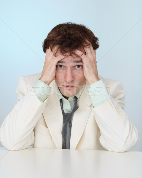 Young businessman sorrowfully recollects yesterday Stock photo © pzaxe