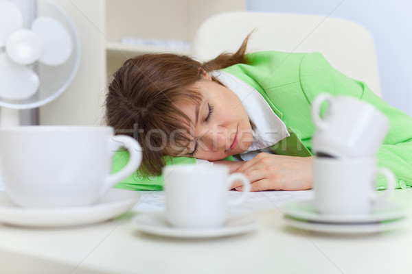 Beautiful woman sleeps on workplace with coffee cups Stock photo © pzaxe