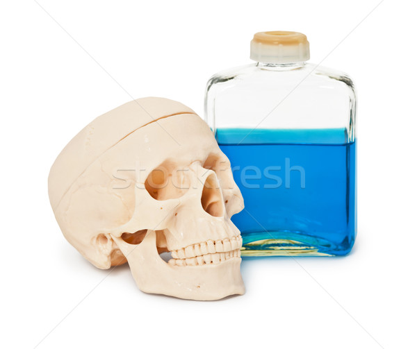 Still-life - bottle with blue poisonous liquid and human skull Stock photo © pzaxe