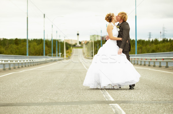 Newlyweds kissing passionately on highway Stock photo © pzaxe