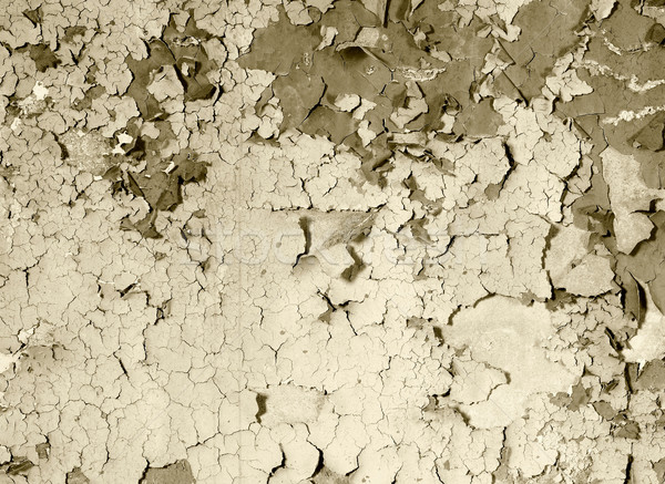 old damaged paint on a concrete wall - sepia Stock photo © pzaxe
