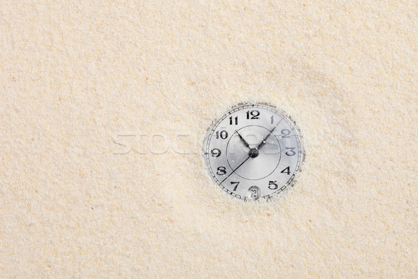 Ancient watch shipped in sand Stock photo © pzaxe