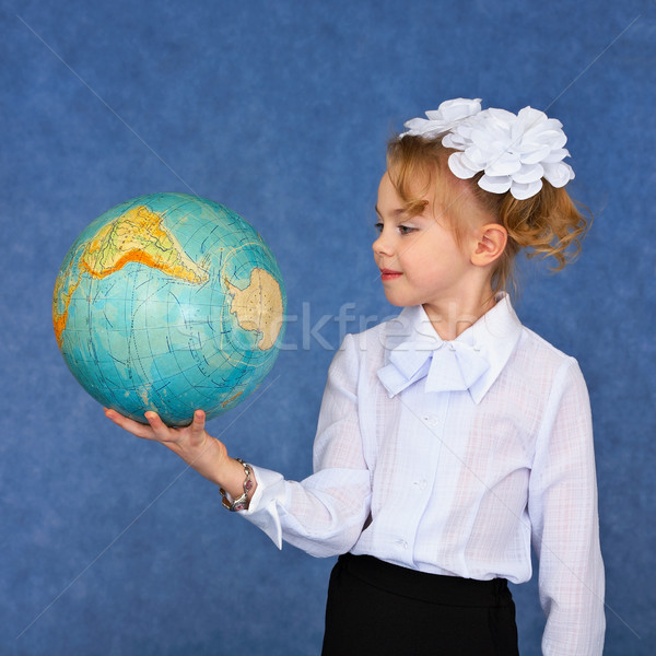 Schoolgirl looking at a geographical globe Stock photo © pzaxe