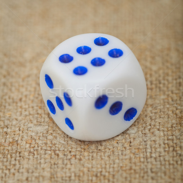 Plastic dice with blue dots on canvas close up Stock photo © pzaxe
