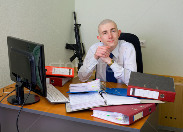 Self-satisfied worker of office armed with a rifle Stock photo © pzaxe