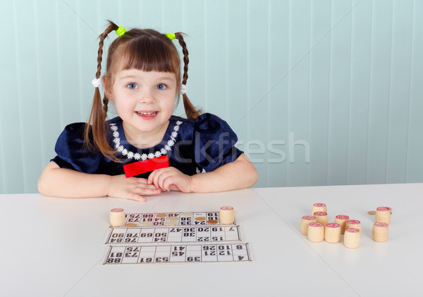 Child at table played with bingo Stock photo © pzaxe
