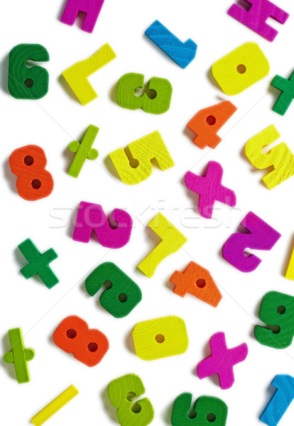 Wooden figures scattered on white background Stock photo © pzaxe