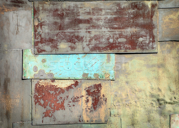 Stock photo: Wall covered with sheets of rusty old steel background