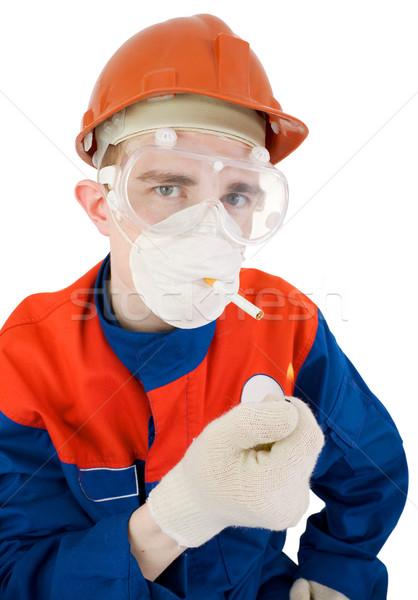 Man in respirator smoking Stock photo © pzaxe