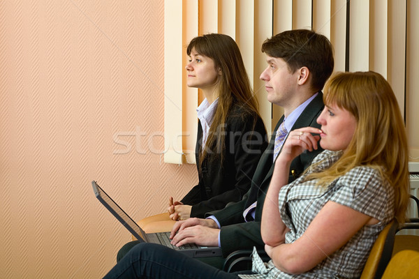 Group of businessmen sitting on armchairs Stock photo © pzaxe