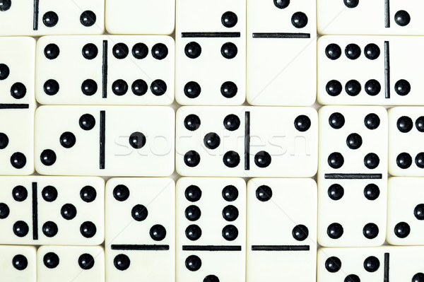 Wall from grey bones of dominoes Stock photo © pzaxe