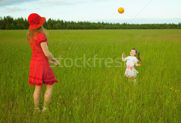 Mum and daughter play with a ball Stock photo © pzaxe