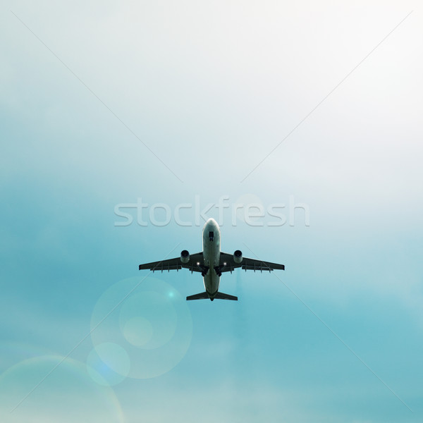 Silhouette of passenger airplane flying in the sky Stock photo © pzaxe