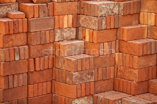 Pile of red bricks prepared for building Stock photo © pzaxe