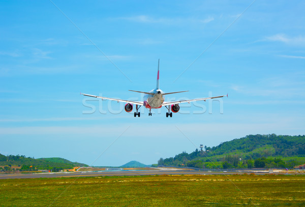 Twin-engine, modern, commercial airliner coming for a landing at Stock photo © pzaxe
