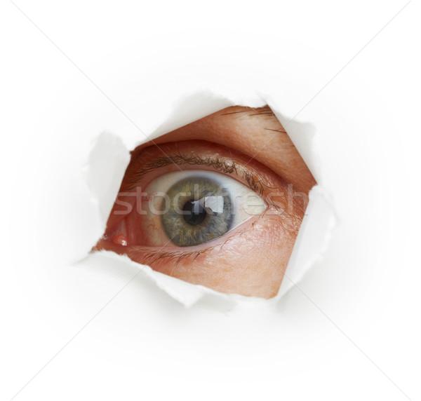 Voyeurism - eye spies through a hole Stock photo © pzaxe