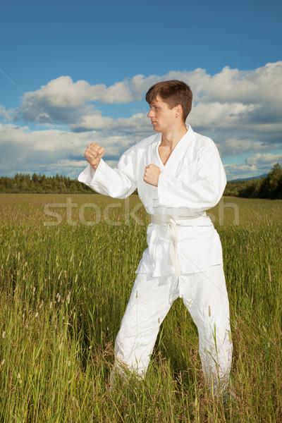 Man in kimono standing in grass Stock photo © pzaxe