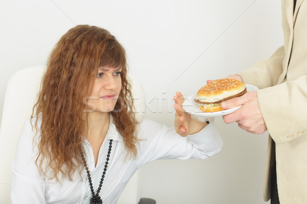 Young beautiful woman refuses harmful food Stock photo © pzaxe