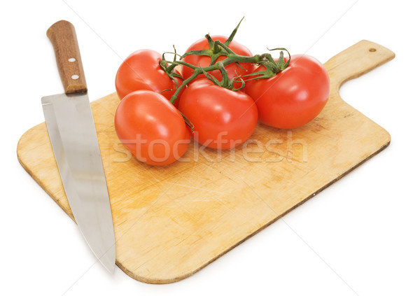 Red tomatoes and kitchen knife on a chopping board Stock photo © pzaxe