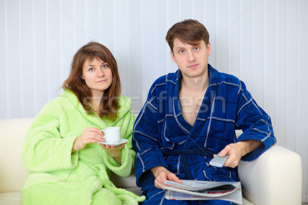 Young couple watching TV on sofa Stock photo © pzaxe