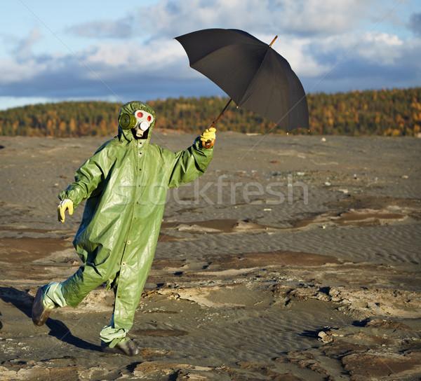 Person in protective scientific overalls with umbrella Stock photo © pzaxe