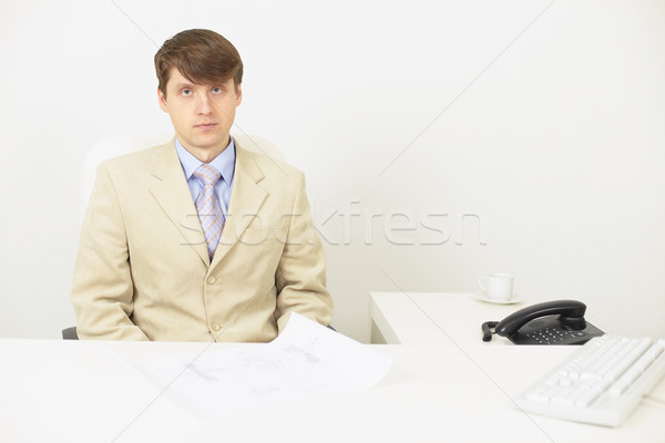 Serious businessman attentively listens Stock photo © pzaxe