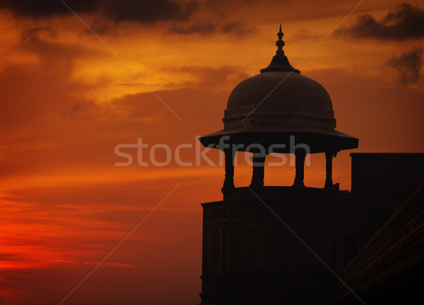 Silhouette of tower on sunset sky background, Red ford, Agra, In Stock photo © pzaxe