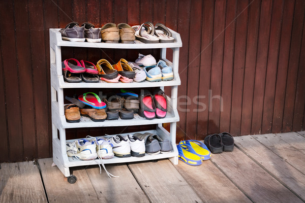 Colorful Shoes on a Plastic Shoe Rack, Outside a House Stock photo © pzaxe