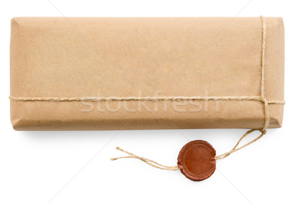 Postal parcel in coarse paper on white background Stock photo © pzaxe