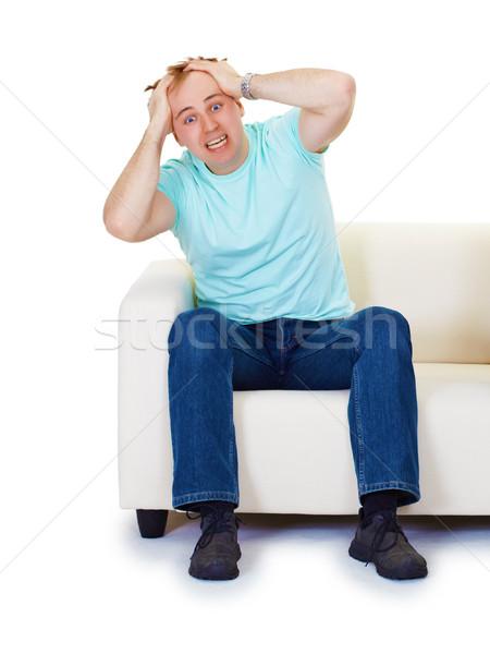 Stockfoto: Nerveus · hysterie · man · home · sofa · geïsoleerd