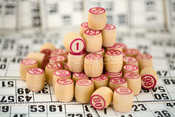 Wooden counters of bingo on cards Stock photo © pzaxe