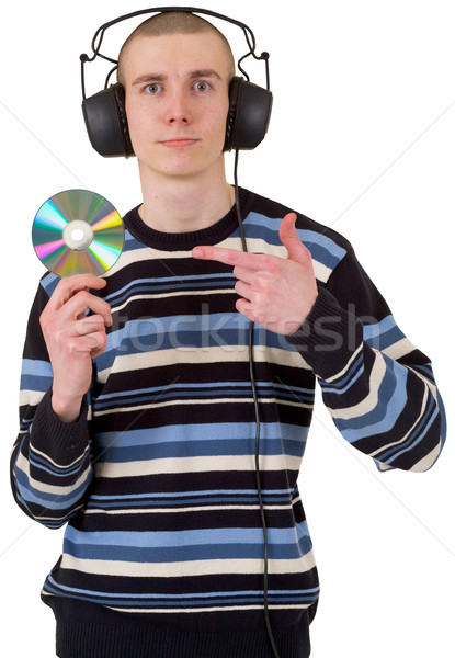 The young guy with ear-phones and a compact disk Stock photo © pzaxe