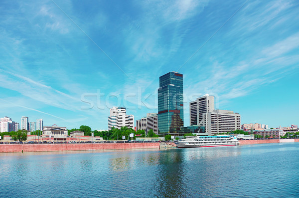 High-rise building on riverbank. Urban landscape Stock photo © pzaxe