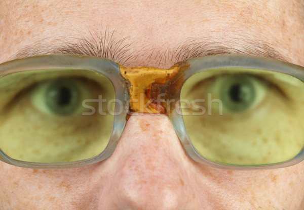 Person in old bad spectacles with poor eyesight Stock photo © pzaxe