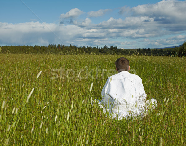 Person is meditation far away from civilization Stock photo © pzaxe