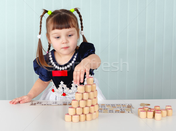 Little girl builds tower of lotto Stock photo © pzaxe