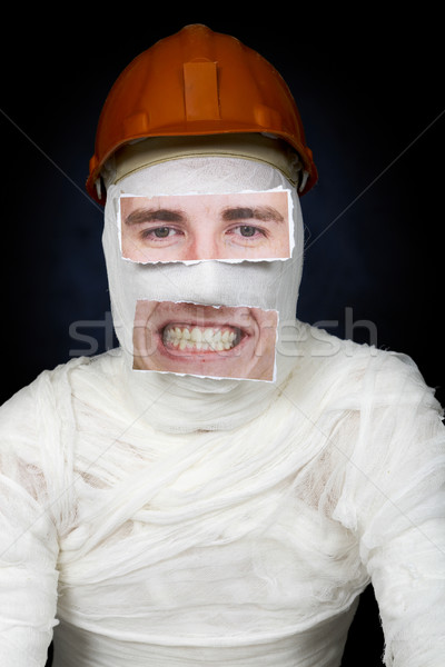 Guy in bandage with the helmet and false face Stock photo © pzaxe