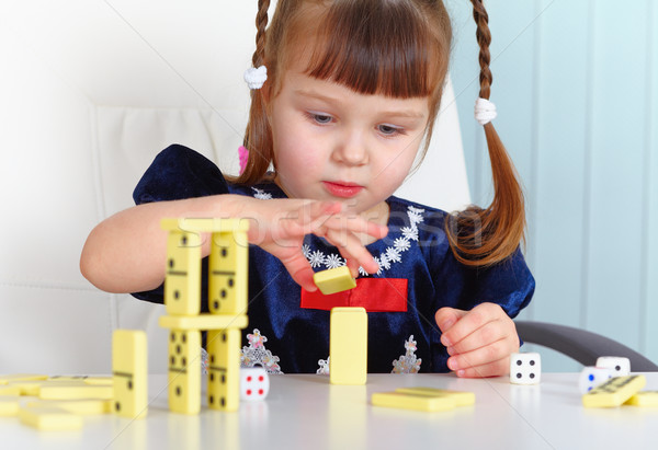 Child playing with dominoes Stock photo © pzaxe