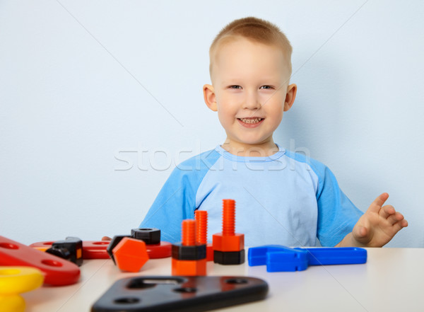 Stock photo: Happy child playing with toys