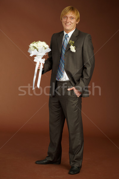 Happy groom with bouquet Stock photo © pzaxe